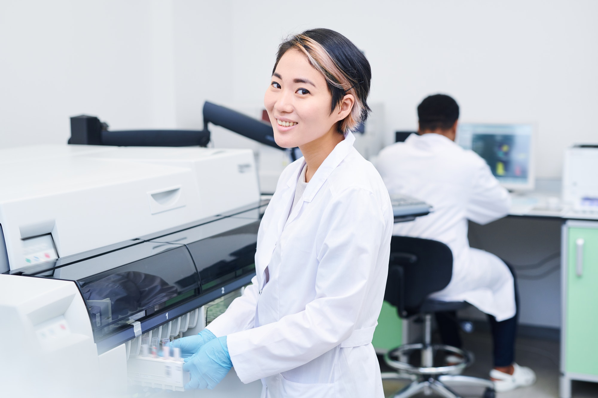 Smiling young laboratory worker